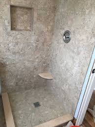 large walk in shower with custom tile using fiberglass shower pan construction