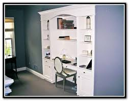 built in shelving units with desk