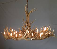 elk antler chandelier with rawhide and mica iron base also 21 up lights and 4 down lights