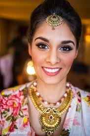 artist indian bride getting ready indian bridal hair and makeup indian wedding necklace