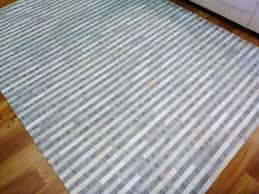 cowhide leather patchwork floor area rug avik lines natural