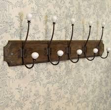 long row five wall mounted coat hooks on wooden plinth amazonco