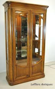 curio display cabinet with beveled glass doors by french exterior