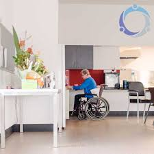 A Woman Is In A Wheelchair Accessible Kitchen Which Makes Her Life So Much  Easier.
