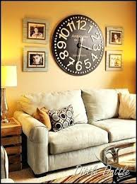 image result for wall with clock in middle and frames on side decor living room clocks