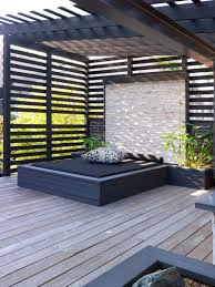 Modern outdoor daybed Patio Furniture This Builtin Outdoor Daybed With Stone Wall And Planters Sits Underneath Pergola That Provides Shade The Alley Exchange 12 Outdoor Daybeds To Get You Dreaming Of Warmer Weather Contemporist