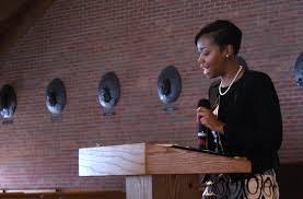 civil rights and social justice black history month conversation mlk contest first place graduate winner dania lofton reads her essay during the event