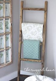 From 'Dwelling in Happiness', build this DIY towel rack with a shelf from  scrap wood and some hooks. Another perfect project for beginners.