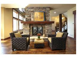stacked stone fireplace with built ins crown molding rounded windows in bookcases um size of living