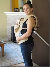 Roll a baby blanket and stick in bottom of ergo baby carrier instead ...