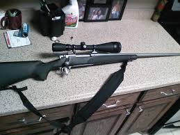 simmons whitetail classic scope. like new model 700 sps stainless 300 win mag matte . great shooting gun .has simmons whitetail classic 6.5x20x50 scope .granite finish