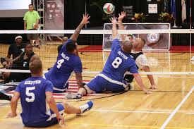 u s department of defense photo essay  retired army sgt sean hook prepares to spike the ball in a sitting volleyball game