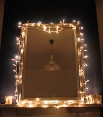 interior square make up mirror with light bulbs around it wall