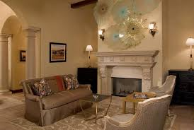 wall sculpture above fireplace living room traditional with wall lighting white shade
