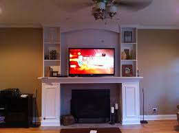 mounting tv above fireplace style built in cabinet new ideas for image of hanging flat screen over electric stand with speakers shelf and on brick mantel