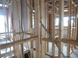 after the builder has rectified any defects from frame stage the services trades plumbers electricians and heating contractors etc come through to