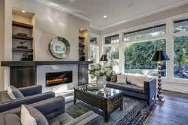 living room with beige walls ceiling and hardwood floor with area rug