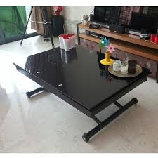 glass coffee table convertible into