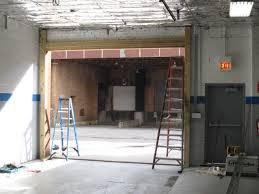 garage door framingFraming a masonry opening to accommodate a new sectional garage