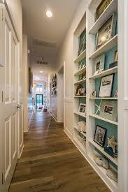 hallway office. hallway with turquoise shelves van wicklen design office