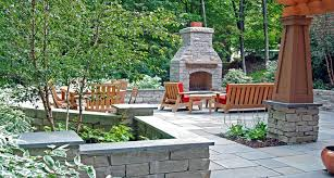 this raised terrace was completely redone with a stone fireplace bluestone patio