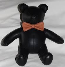 this teddy bear is sure to be a hit it s one of the sportiest teddy bears around black leather bear with a basket ball leather bow tie
