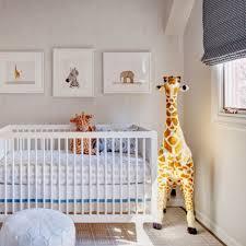baby bedroom simple ivory animal baby boy nursery room area white round chair white crib high