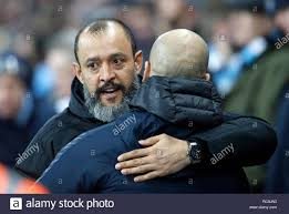 Wolverhampton Wanderers manager Nuno Espirito Santo (left) and Manchester  City manager Pep Guardiola hug prior to the Premier League match at the  Etihad Stadium, Manchester Stock Photo - Alamy