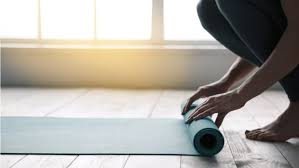 rolling out yoga mat