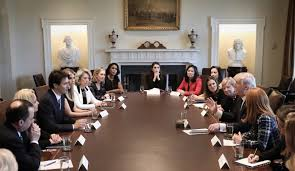 prime minister justin trudeau and u s president donal trump listen to women speak during roundtable discussion