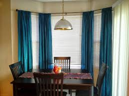 Bay Window Drapes Ideas With Rectangle Table Wooden Chairs Under Silver  Pendant Lamp