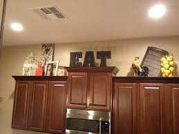 Staging Above Kitchen Cabinets Have A Trendy Kitchen By Decorating