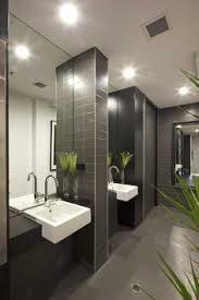 office washroom design. restroom palette. unique size of horizontal tiles used on accent walls. greenery office washroom design