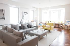 white gray color palette interior design grey sectional sofa yellow side chair modern new york city