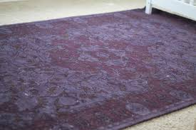 it s the bursa wool rug in merlot curly sold out from west elm we had actually been going back and forth getting the 9 12 navy one for our living