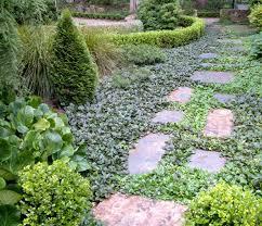 traditional garden by arthur lathouris garden designer