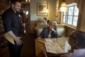 olive garden server david mcdonald left talks to anita and greg harrant both