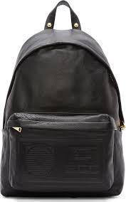 versus black leather tape deck embossed backpack 750 ssense lookastic com