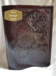 custom made hand carved leather book cover made from quality thick veg tan leather this item is entirely hand tooled hand sewn and dyed i will make