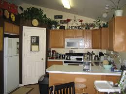 Decor Over Kitchen Cabinets Decor Above Kitchen Cabinets Dark Chimney Floating Cabinets Gold