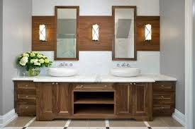 unique bathroom furniture. this symmetrical design features identical sinks above a white granite countertop contrasted by the dark unique bathroom furniture