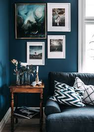 Step Inside A Blogger's Cozy And Eclectic Swedish Home INSPIRE Stunning Blue Color Living Room