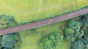 Grass field aerial Tall Grass Aerial View Of Railway In Between Grass Field Surrounded By Trees Peakpx Aerial View Of Railway In Between Grass Field Surrounded By Trees
