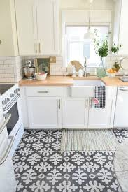 fascinating wooden countertops and white cabinets combination for small kitchen design ideas using patterned tiles floor