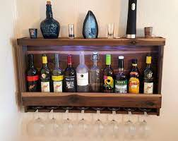 wall mounted and lighted liquor cabinet