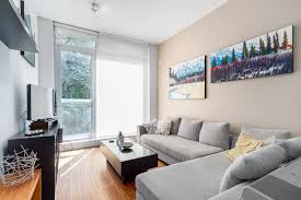 View in gallery Elegant little living room of the Water Street apartment  flooded with natural light