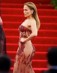 Cele bitchy Jennifer Lopez in red Versace at the Met Gala on.