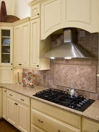 stainless vent hood attached to kitchen cabinets