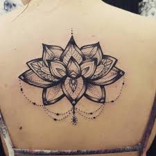 awesome black ink lotus flower tattoo on upper back