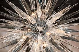 a stunning spiked sputnik chandelier that features a polished nickel spherical center surrounded by handblown murano